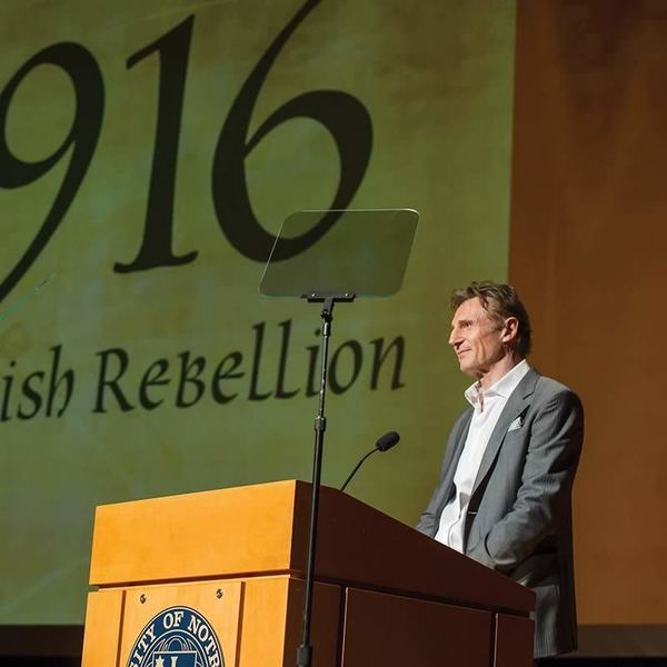 Liam Neeson, narrator of the film gives opening remarks at the Gala Premiere of the documentary 1916: The Irish Rebellion in the Leighton Concert Hall at the DeBartolo Performing Arts Center in Notre Dame, IN.