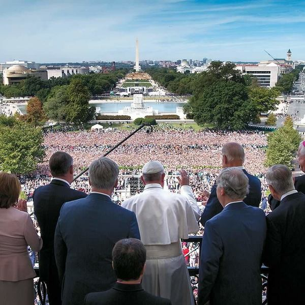 Pope Francis waves to the crowd from the Speakers Balcony at the US Capitol  in Washington, DC.